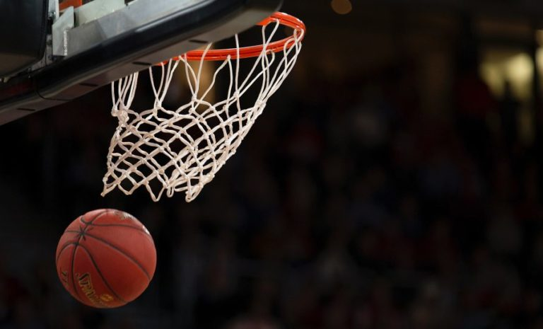 Basketball falling through the hoop at a game