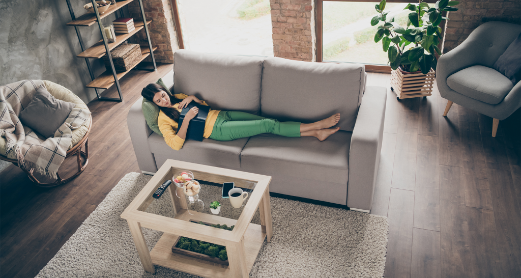 Woman in self isolation on the couch at home