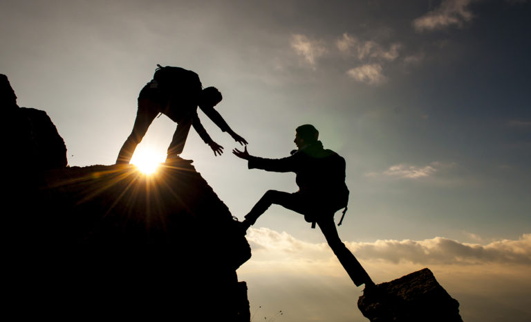 Two friends rock climbing together